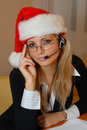 Phone operator with a christmas cap Royalty Free Stock Photo