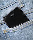 Phone in pocket black smart jeans Stock Images