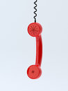 Phone receiver hanging d render of red Royalty Free Stock Photos