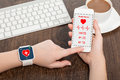 Phone and smart watch with mobile app health sensor female hands holding touch Stock Images