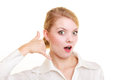 Phone. Surprised businesswoman making call me gesture Royalty Free Stock Photo