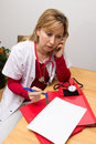 Phoning nurse and making a memcon Stock Photo