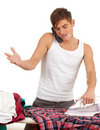 Phoning, smoking man ironing clothes Stock Photos