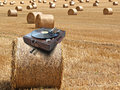 Phonograph on hay bale Royalty Free Stock Photo