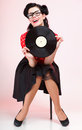 Phonography analogue record girl pin up retro style sexy american woman Royalty Free Stock Photo