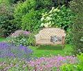 Garden of peace paradise chaise lounge longue gardens cat pets pet animals eden peaceful chair seat bench Royalty Free Stock Photo