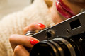 Photo of beautiful girl who& x27;s holding a vintage camera Royalty Free Stock Photo