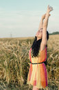 Photo of beautiful woman standing on wheat field pretty teen girl stand golden rye land with raised open hands and looking up Royalty Free Stock Photography