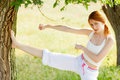 Photo of beautiful young woman doing joga on the wonderful trees Royalty Free Stock Photo