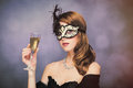 Photo of beautiful young woman in mask with wineglass of champag Royalty Free Stock Photo