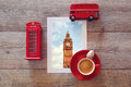 Photo of big ben in london on wooden table with coffee cup and souvenirs british Royalty Free Stock Images