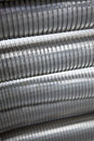 Photo of big flexible steel tubes as used in the industry Stock Photography