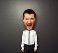 Photo of bighead screaming man over dark background Royalty Free Stock Photography