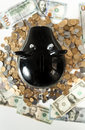 Photo of black piggy bank on pile of coins closeup Stock Photography