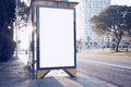 Photo blank lightbox on bus stop in the modern city. Horizontal mockup, sunlight Royalty Free Stock Photo