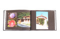 Photo book a black customized showing colorful holiday photographs of nature in italy image isolated on white studio background Stock Images