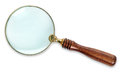 Photo brass magnifying glass wooden handle isolated white background clipping path both outline internal glass area Royalty Free Stock Image