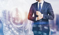 Photo of businessman wearing suit and visual interfaces effects on screen blurred horizontal Royalty Free Stock Photography