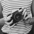 Photo camera in the hands of the girl Royalty Free Stock Photo