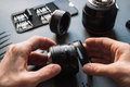 Photo camera lens repair set technician engineer disassembling align and adjusts mm s hands and Stock Images