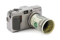 Photo camera and money isolated on white background Royalty Free Stock Photos