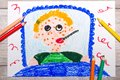 Photo of colorful drawing: sad sick boy lies in a bed. Royalty Free Stock Photo