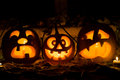 Photo composition from three pumpkins on Halloween. Royalty Free Stock Photo