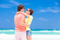 Photo of couple in bright clothes hugging on tropical beach tulum this image has attached release Stock Photography