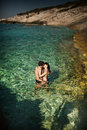 Photo of couple kissing in tropical water clear Stock Image