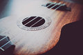 Photo depicts musical instrument ukulele guitar. Royalty Free Stock Photo
