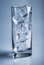 Photo of empty glass with ice cubes on studio shot Royalty Free Stock Photo