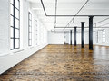 Photo of empty interior in modern building.Open space loft. Empty white walls. Wood floor, black beams,big windows Royalty Free Stock Photo