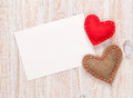 Photo frame or greeting card and handmaded toy hearts Royalty Free Stock Photo