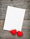 Photo frame and small red candy hearts on wooden background Stock Images