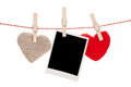 Photo frame and valentines day toy hearts hanging on rope isolated on white background Royalty Free Stock Photo