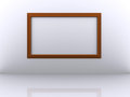 Photo frame on the white wall Royalty Free Stock Photos
