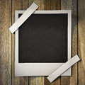 Photo frame on a wooden background Royalty Free Stock Images