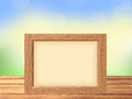 Photo frame on wooden table on nature background Royalty Free Stock Photo