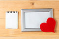Photo frames, blank card and handmade hearts over wooden background Royalty Free Stock Photo