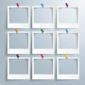 Photo frames colored thumbtacks with on the gray background Royalty Free Stock Photography