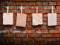 Photo frames with pins on rope over old aged brick wall Royalty Free Stock Photo