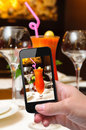 Photo fresh juice hands taking with smartphone Royalty Free Stock Images