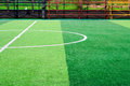 Photo of a green synthetic grass sports field with white line sh Royalty Free Stock Photo