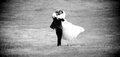 Photo of groom lifting bride and spinning her black white Stock Photography