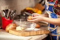 Photo of housewife cracking egg with knife Royalty Free Stock Photo