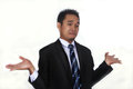 Photo image of a handsome attractive young Asian businessman with i don`t know gesture