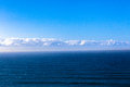 Photo image overlooking the ocean and blue sky and clouds above the sea ocean swells Royalty Free Stock Photo