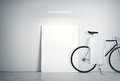 Photo Interior Modern Studio Loft with Concrete Wall and Classic bicycle.Empty White Canvas on Floor, Spotlight top Royalty Free Stock Photo