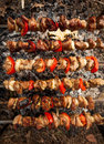 Photo of kebab being roasted on fire wide angle Stock Photos