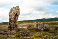 Photo of the large standing stones in the area of varna in bulgaria field with a lot natural lying Royalty Free Stock Photo